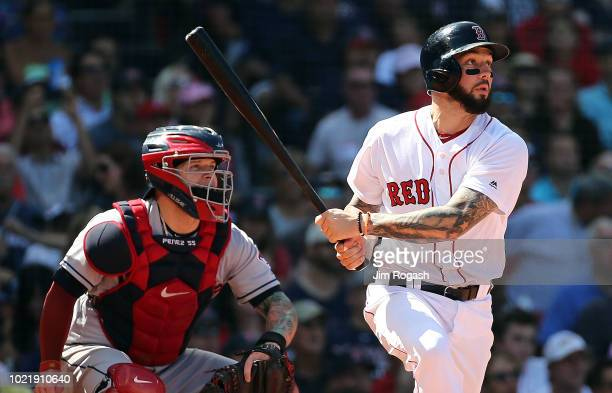 Blake Swihart of the Boston Red Sox doubles in two runs in the fifth against the Cleveland Indians in the third inning at Fenway Park on August 23...