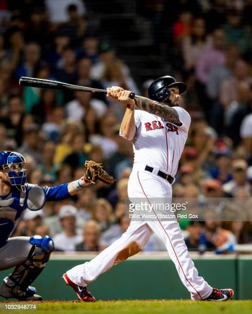 Blake Swihart of the Boston Red Sox hits a pop fly that was dropped by Yangervis Solarte of the Toronto Blue Jays to allow the go ahead run during...