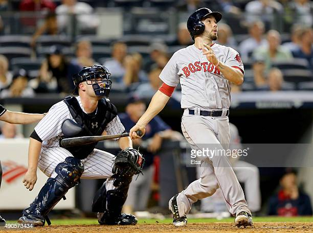 Blake Swihart of the Boston Red Sox hits a two run home run in the eighth inning as Brian McCann of the New York Yankees defends on September 29 2015...