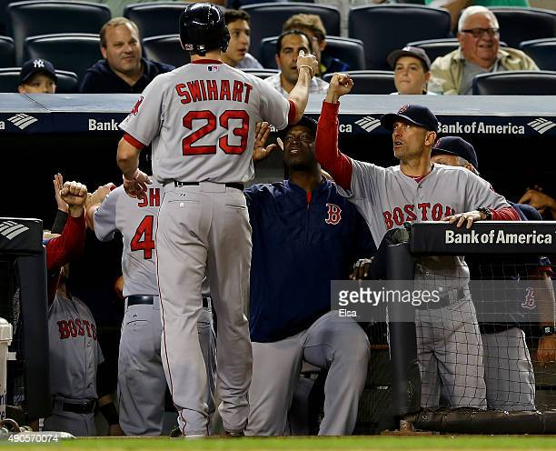 Blake Swihart of the Boston Red Sox is congratulated by teammates in the dugout after he hit a three run home run in the first inning against the New...