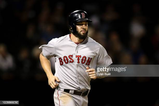 Blake Swihart of the Boston Red Sox jogs to first base after drawing a walk in the ninth inning against the Chicago White Sox at Guaranteed Rate...