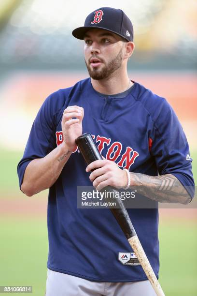 Blake Swihart of the Boston Red Sox looks on during batting practice of a baseball game against the Baltimore Orioles at Oriole Park at Camden Yards...