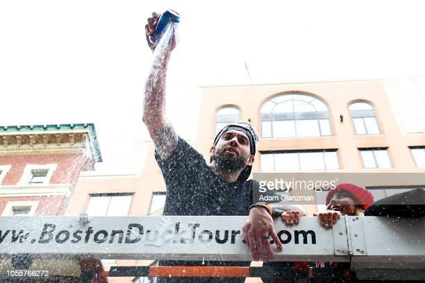 Blake Swihart of the Boston Red Sox opens a beer can during the 2018 World Series victory parade on October 31 2018 in Boston Massachusetts