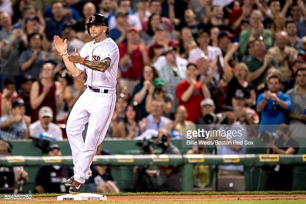 Blake Swihart of the Boston Red Sox reacts after hitting an RBI triple during the fourth inning of a game against the Colorado Rockies on May 25 2016...