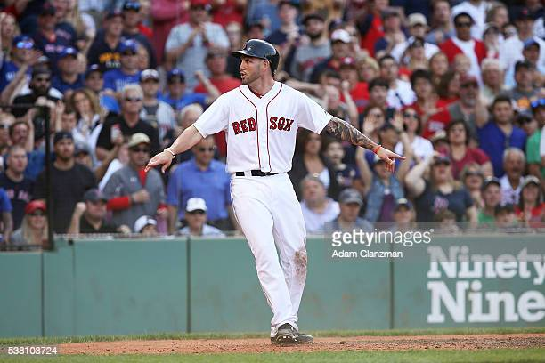 Blake Swihart of the Boston Red Sox reacts after scoring in the sixth inning during the game against the Tornoto Blue Jays at Fenway Park on June 4...
