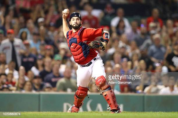 Blake Swihart of the Boston Red Sox throws to first base in the eighth inning of a game against the Tampa Bay Rays at Fenway Park on August 17 2018...