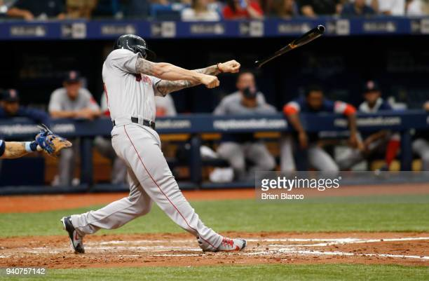 Blake Swihart of the Boston Red Sox tosses his bat into the Tampa Bay Rays' dugout while facing pitcher Jacob Faria of the Tampa Bay Rays during the...