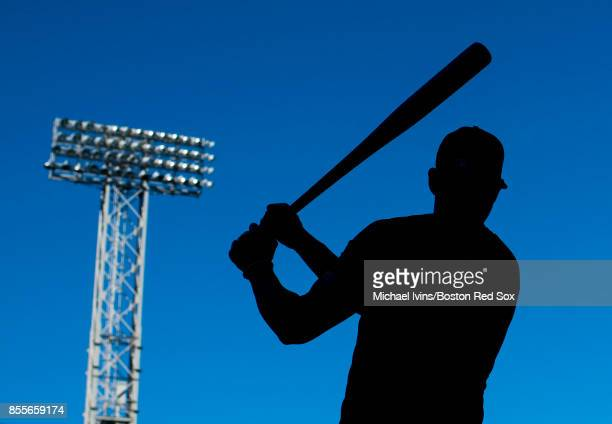 Blake Swihart of the Boston Red Sox warms up before a game against the Houston Astros at Fenway Park on September 29 2017 in Boston Massachusetts
