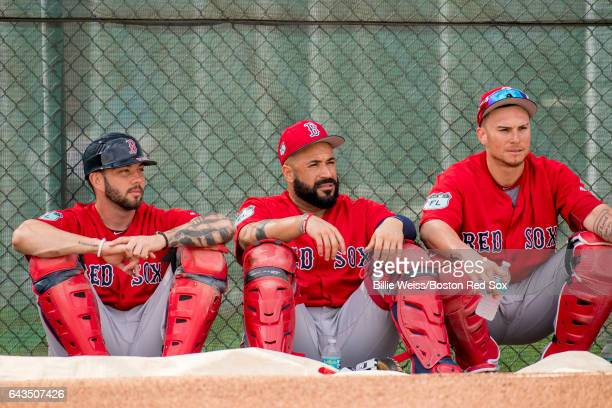 Blake Swihart Sandy Leon and Christian Vazquez of the Boston Red Sox look on during a team workout on February 21 2017 at Fenway South in Fort Myers...
