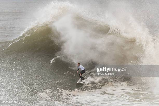 Blake Thornton rides a huge wave during Cape Fear on June 6 2016 in Sydney Australia