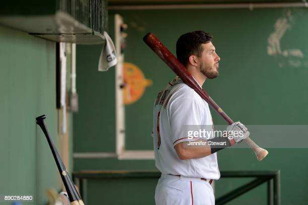 Blake Trahan of Scottsdale Scorpions looks on from the dugout in the Arizona Fall League game against the Surprise Saguaros at Scottsdale Stadium on...
