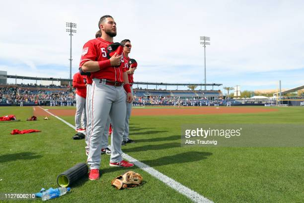 Blake Trahan of the Cincinnati Reds stands for the national anthem ahead of a Spring Training game against and the Seattle Mariners on Monday...