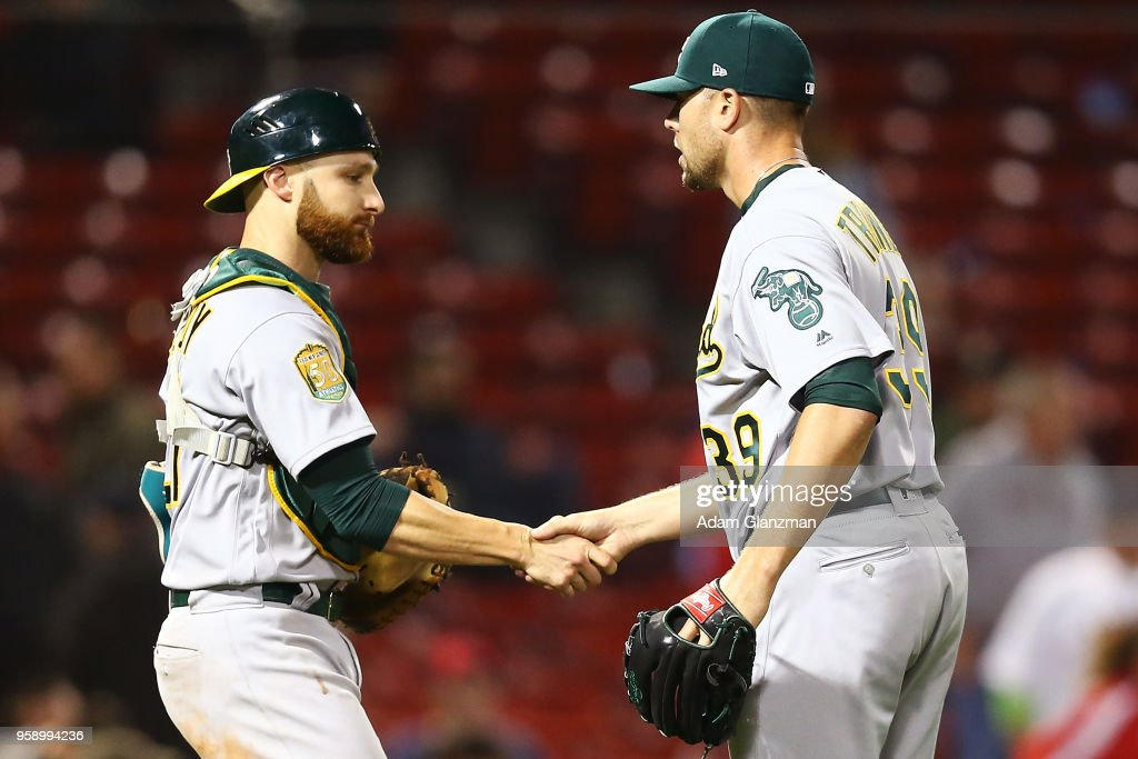 Blake Treinen #39 and Jonathan Lucroy #21 of the Oakland Athletics shake hands after a victory over the Boston Red Sox at Fenway Park on May 15, 2018 in Boston, Massachusetts.