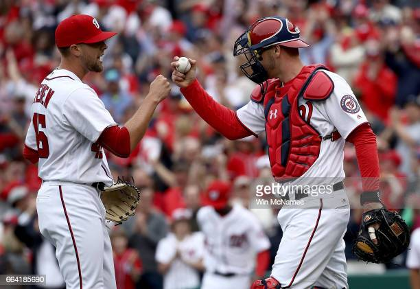 Blake Treinen is congratulated by teammate Matt Wieters after getting the save for the Washington Nationals in the Opening Day game against the Miami...