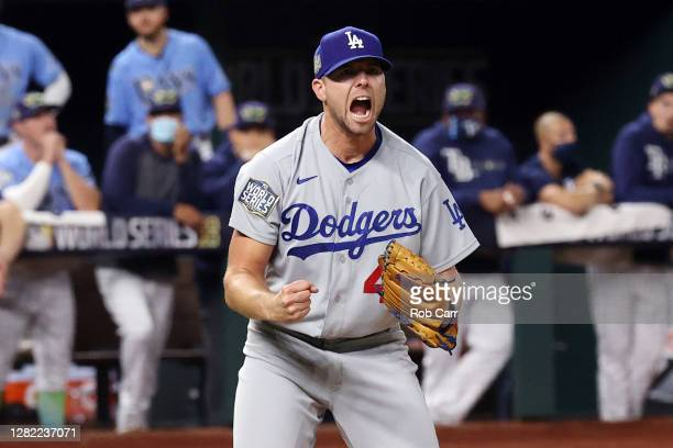 Blake Treinen of the Los Angeles Dodgers celebrates after striking out Willy Adames of the Tampa Bay Rays to secure the 42 victory in Game Five of...