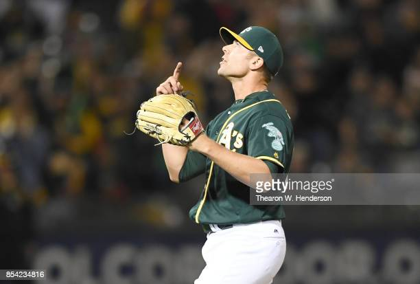 Blake Treinen of the Oakland Athletics celebrates after striking out ShinSoo Choo of the Texas Rangers for the final out of the game at Oakland...