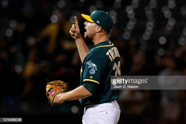 Blake Treinen of the Oakland Athletics celebrates after the game against the Seattle Mariners at the Oakland Coliseum on August 13 2018 in Oakland...