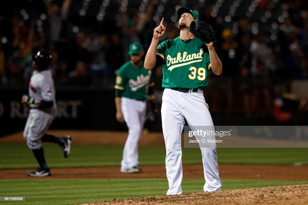Blake Treinen #39 of the Oakland Athletics celebrates after the game against the Cleveland Indians at the Oakland Coliseum on June 29, 2018 in Oakland, California. The Oakland Athletics defeated the Cleveland Indians 3-1.