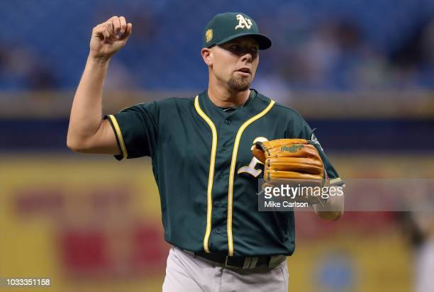 Blake Treinen of the Oakland Athletics celebrates at the end of the tenth inning of a baseball game against the Tampa Bay Rays at Tropicana Field on...