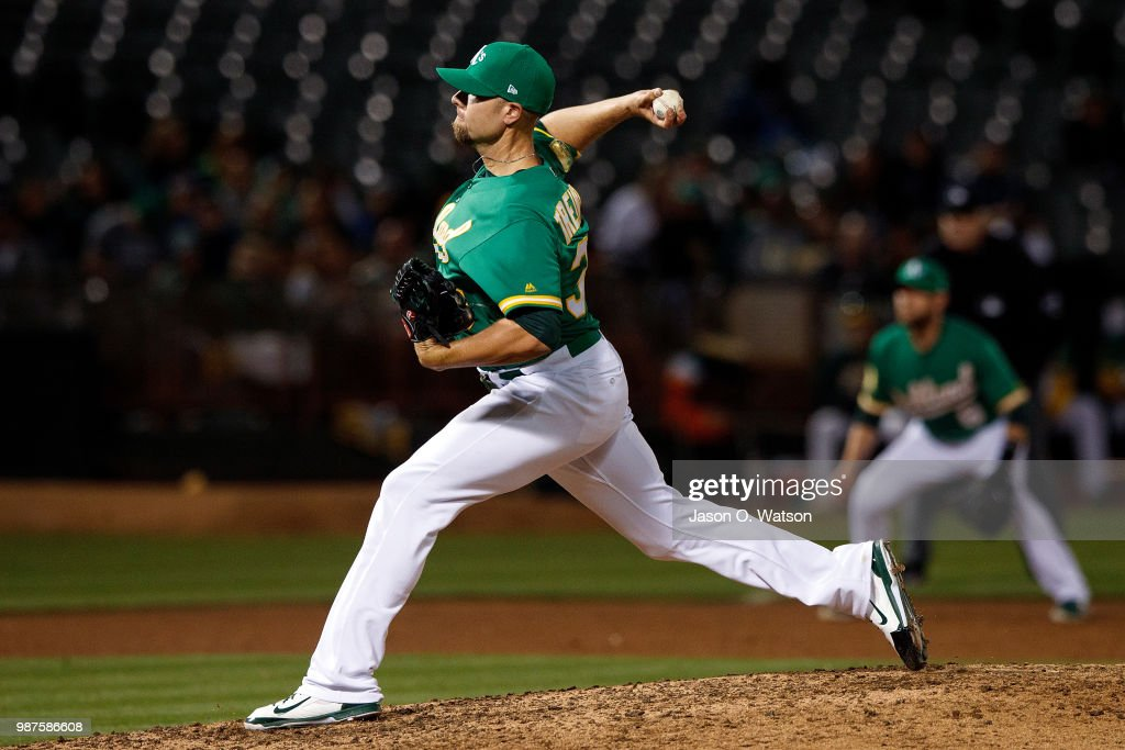 Blake Treinen #39 of the Oakland Athletics pitches against the Cleveland Indians during the ninth inning at the Oakland Coliseum on June 29, 2018 in Oakland, California. The Oakland Athletics defeated the Cleveland Indians 3-1.