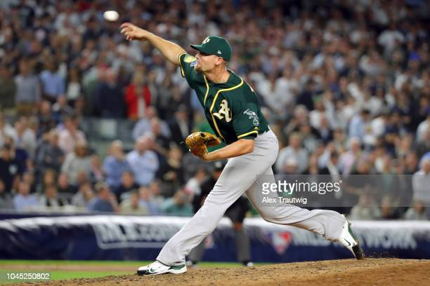 Blake Treinen of the Oakland Athletics pitches in the sixth inning during the American League Wild Card game against the New York Yankees at Yankee...