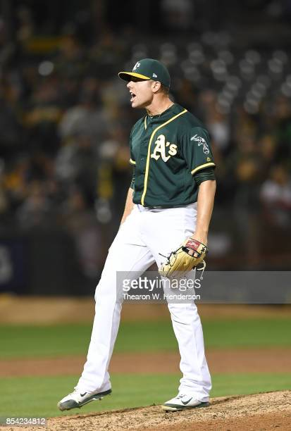 Blake Treinen of the Oakland Athletics reacts after striking out ShinSoo Choo of the Texas Rangers in the top of the ninth inning for the final out...