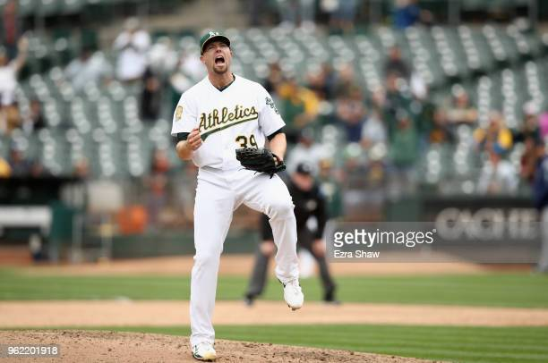 Blake Treinen of the Oakland Athletics reacts after they beat the Seattle Mariners at Oakland Alameda Coliseum on May 24 2018 in Oakland California