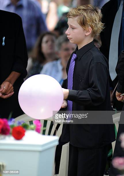 Blake Tyson mourns at the funeral of his mother Donna Maree Rice and older brother Jordan Rice killed in last week's flash floods on January 19 2011...