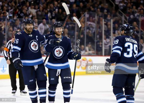 Blake Wheeler and Kyle Connor of the Winnipeg Jets are all smiles as they celebrate a second period goal against the Colorado Avalanche with teammate...