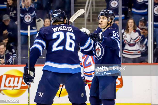 Blake Wheeler and Mark Scheifele of the Winnipeg Jets celebrate a first period goal against the New York Rangers at the Bell MTS Place on February 12...