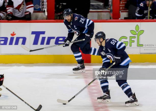 Blake Wheeler and Mark Scheifele of the Winnipeg Jets play the puck up the ice during third period action against the Arizona Coyotes at the Bell MTS...