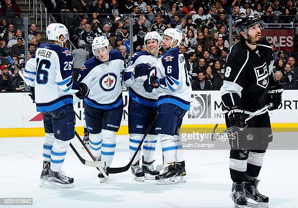 Blake Wheeler Jacob Trouba Nikolaj Ehlers and Alexander Burmistrov of the Winnipeg Jets celebrate Ehlers' second period goal against the Los Angeles...
