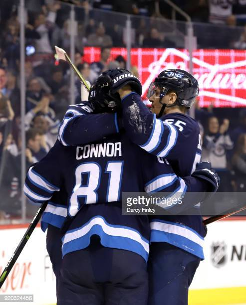 Blake Wheeler Kyle Connor and Mark Scheifele of the Winnipeg Jets celebrate a first period goal against the Florida Panthers at the Bell MTS Place on...