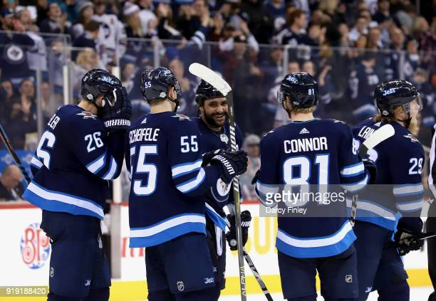 Blake Wheeler Mark Scheifele Dustin Byfuglien Kyle Connor and Patrik Laine of the Winnipeg Jets head to the bench after celebrating a second period...