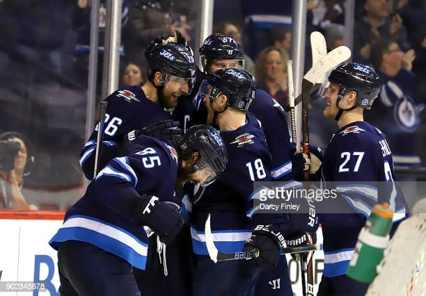 Blake Wheeler Mathieu Perreault Bryan Little Tyler Myers and Nikolaj Ehlers of the Winnipeg Jets celebrate a second period goal against the San Jose...