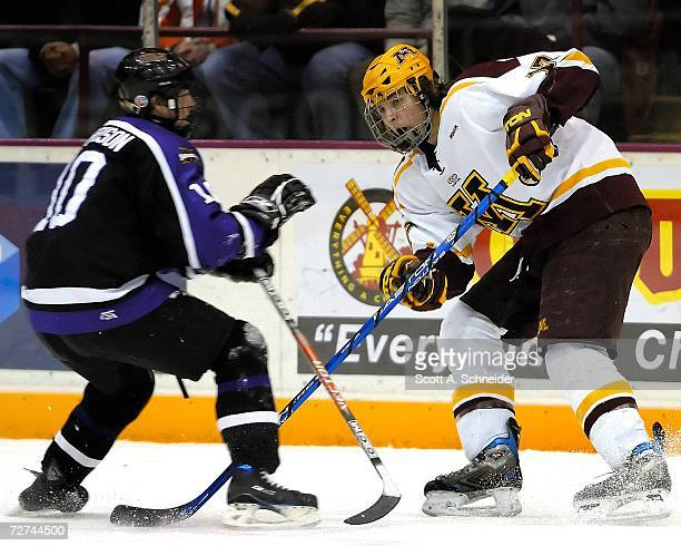 Blake Wheeler of the Minnesota Gophers passes against Zach Harrison of the Minnesota State Mavericks on December 1 2006 at Mariuccci Arena in...