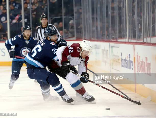 Blake Wheeler of the Winnipeg Jets and Gabriel Landeskog of the Colorado Avalanche battle for the puck during first period action at the Bell MTS...