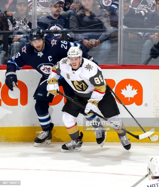 Blake Wheeler of the Winnipeg Jets and Nate Schmidt of the Vegas Golden Knights keep an eye on the play during second period action at the Bell MTS...