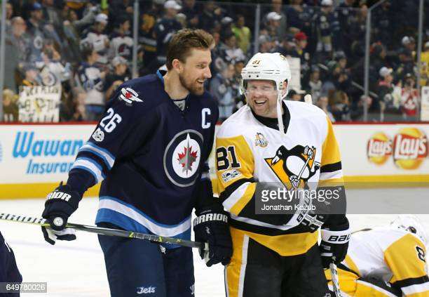 Blake Wheeler of the Winnipeg Jets and Phil Kessel of the Pittsburgh Penguins share a laugh during the pregame warm up at the MTS Centre on March 8...