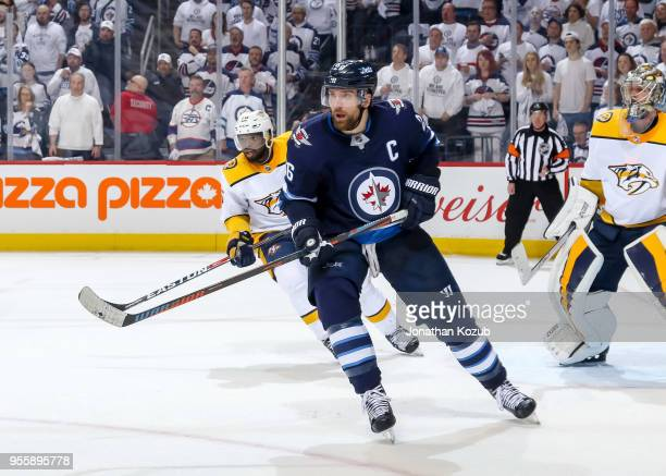 Blake Wheeler of the Winnipeg Jets and P.K. Subban of the Nashville Predators keep an eye on the play during third period action in Game Four of the...