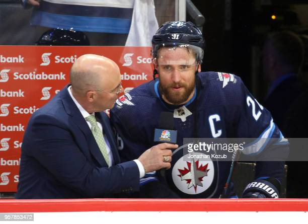 Blake Wheeler of the Winnipeg Jets answers questions during a postgame interview with NBC Sports reporter Pierre McGuire following a 42 victory over...