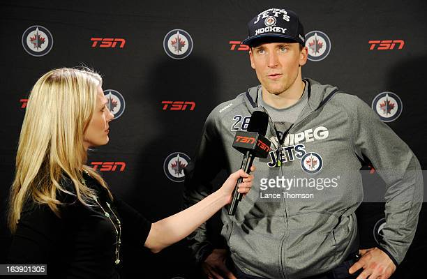 Blake Wheeler of the Winnipeg Jets answers questions from TSNJets reporter Sara Orlesky following a 5-2 victory over the Toronto Maple Leafs at the...