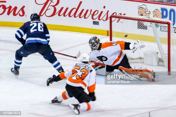 Blake Wheeler of the Winnipeg Jets backhands a shorthanded goal against goaltender Anthony Stolarz of the Philadelphia Flyers for a second period...