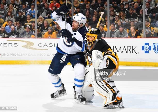 Blake Wheeler of the Winnipeg Jets battles for position against MarcAndre Fleury of the Pittsburgh Penguins at PPG Paints Arena on February 16 2017...