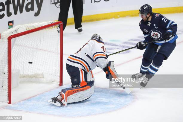Blake Wheeler of the Winnipeg Jets beats Mike Smith of the Edmonton Oilers for a goal in Game Three of the First Round of the 2021 Stanley Cup...