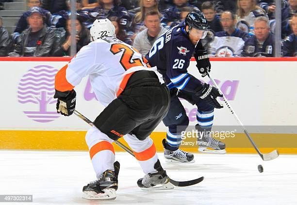 Blake Wheeler of the Winnipeg Jets carries the puck down the ice as Luke Schenn of the Philadelphia Flyers defends during thirdperiod action at the...