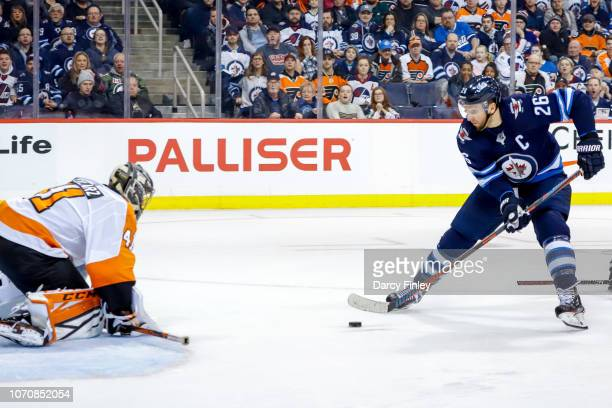 Blake Wheeler of the Winnipeg Jets carries the puck in on goaltender Anthony Stolarz of the Philadelphia Flyers during a second period breakaway at...