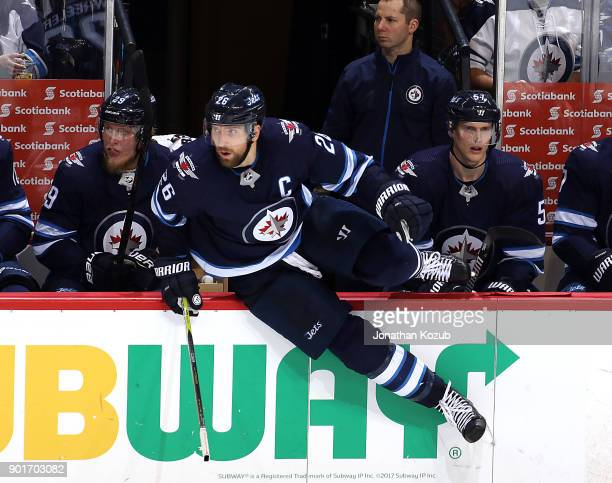 Blake Wheeler of the Winnipeg Jets changes on the fly during third period action against the Buffalo Sabres at the Bell MTS Place on January 5 2018...