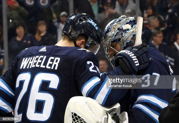 Blake Wheeler of the Winnipeg Jets congratulates goaltender Connor Hellebuyck following a 62 victory over the Chicago Blackhawks at the Bell MTS...