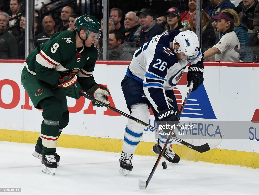Blake Wheeler #26 of the Winnipeg Jets controls the puck against Mikko Koivu #9 of the Minnesota Wild during the first period in Game Three of the Western Conference First Round during the 2018 NHL Stanley Cup Playoffs at Xcel Energy Center on April 15, 2018 in St Paul, Minnesota. The Wild defeated the Jets 6-2.